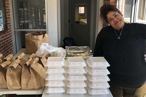 Woman standing next to prepared meals