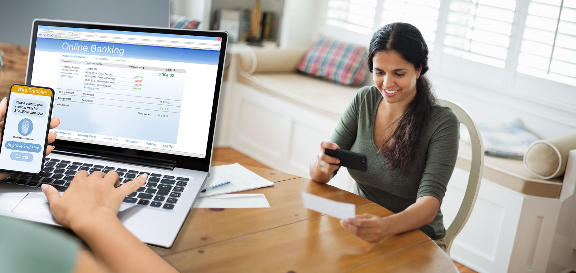 Woman sitting at home using phone to deposit a check